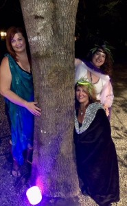 Three Goddess behind tree